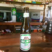 Grab a Belikin at a beachside bar