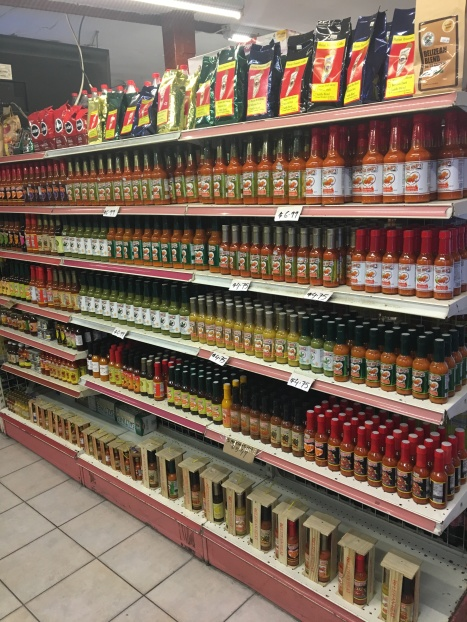 Check out the hot sauce scene at the local corner stores